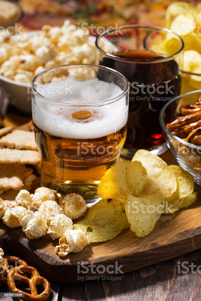 beer and an assortment of snacks, vertical top view stock photo