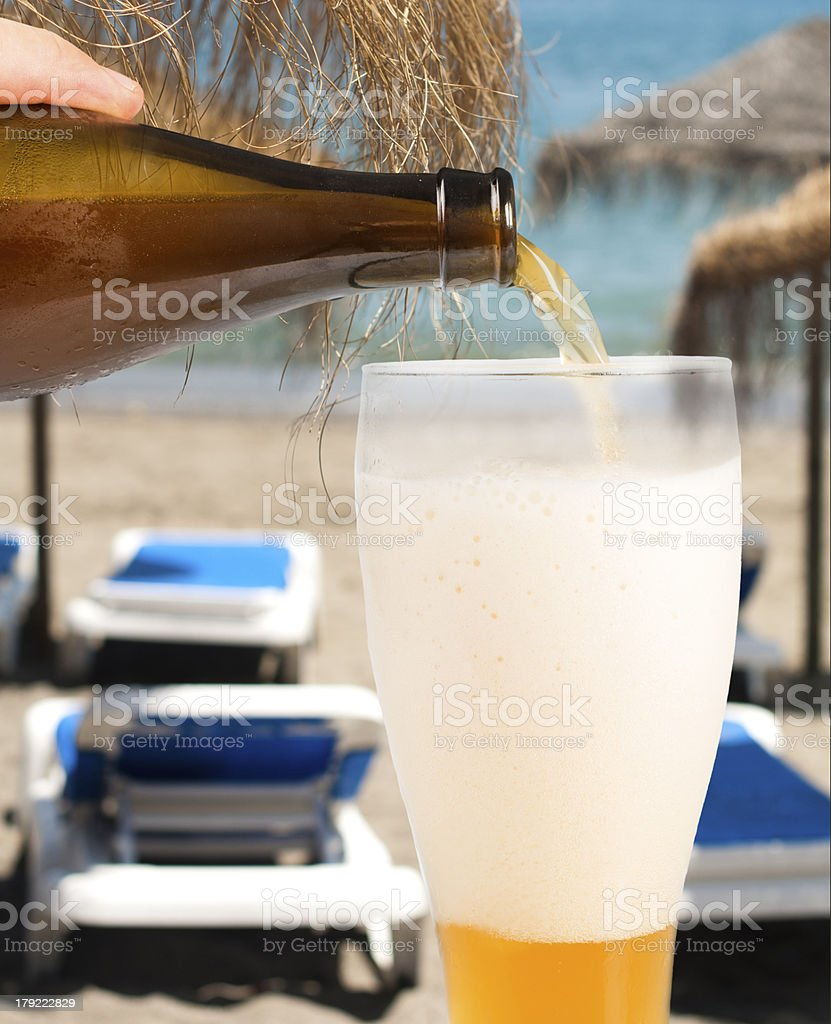 Beer and beach background royalty-free stock photo