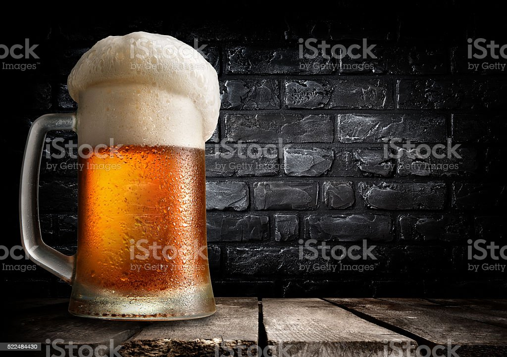 Beer and brick wall stock photo