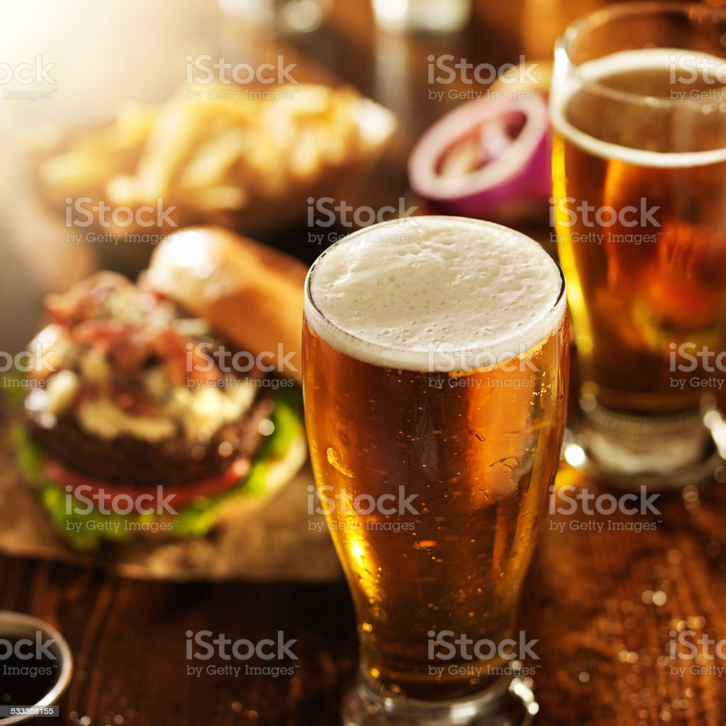 beer and burgers on wooden table stock photo