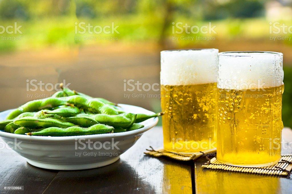 Beer and edamame stock photo