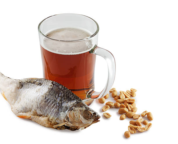 Beer and fish Fresh chilled glass of beer, isolated on a white background. anhydrous stock pictures, royalty-free photos & images