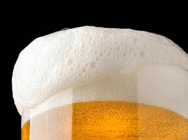 beer and froth - beer foam stock photos and pictures