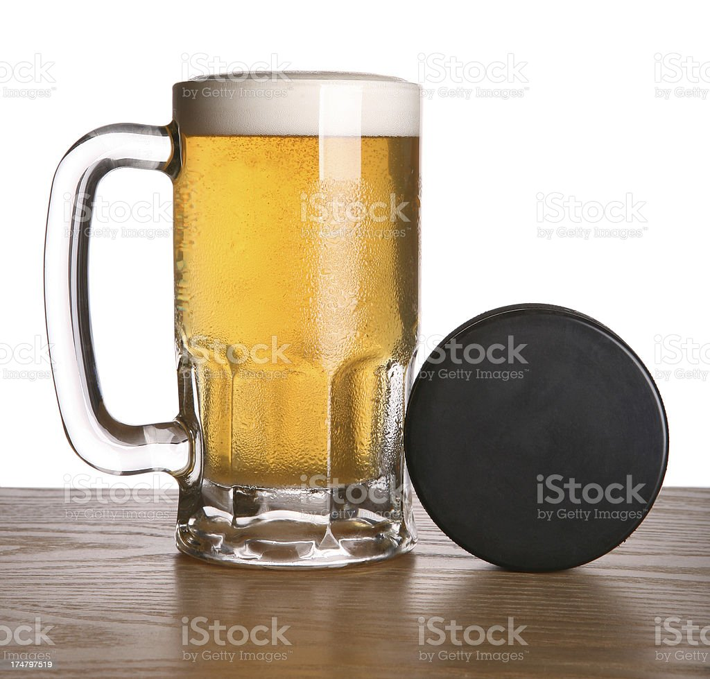 Beer and Hockey Puck royalty-free stock photo