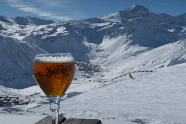 Beer and mountains at a ski resort stock photo