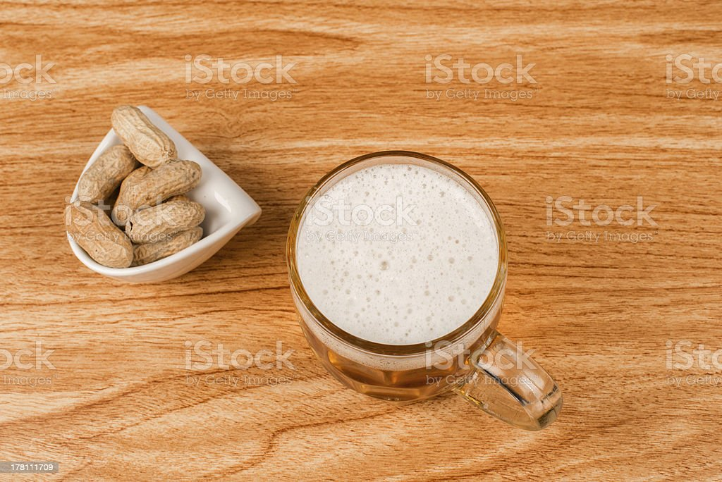 Beer and peanuts high angle stock photo