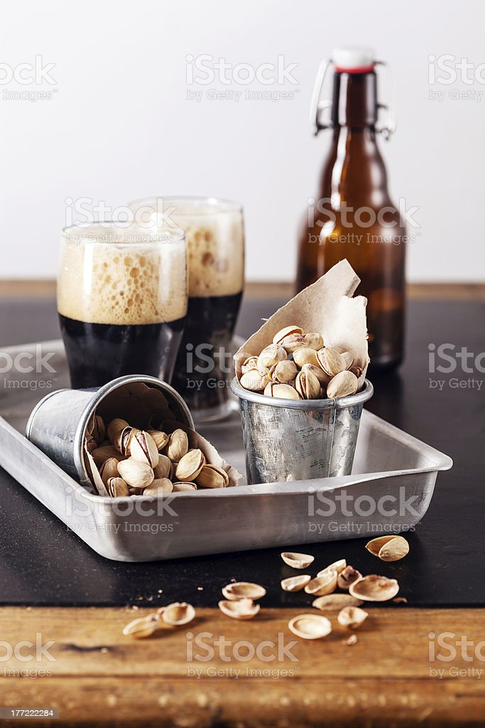 beer and pistachios stock photo