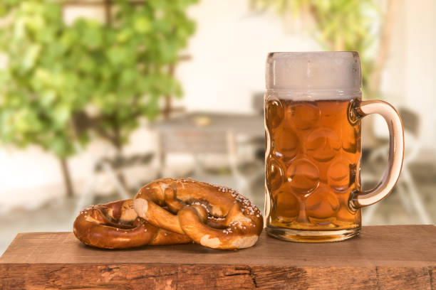 Beer and pretzel in the beer garden stock photo
