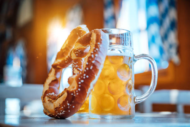 beer and pretzel, oktoberfest munich, germany - german culture stock pictures, royalty-free photos & images