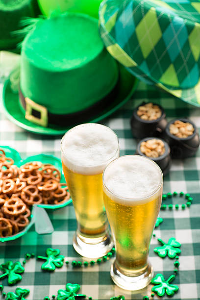 beer and pretzels in irush pub st. patricks day party - st patricks day food stock photos and pictures