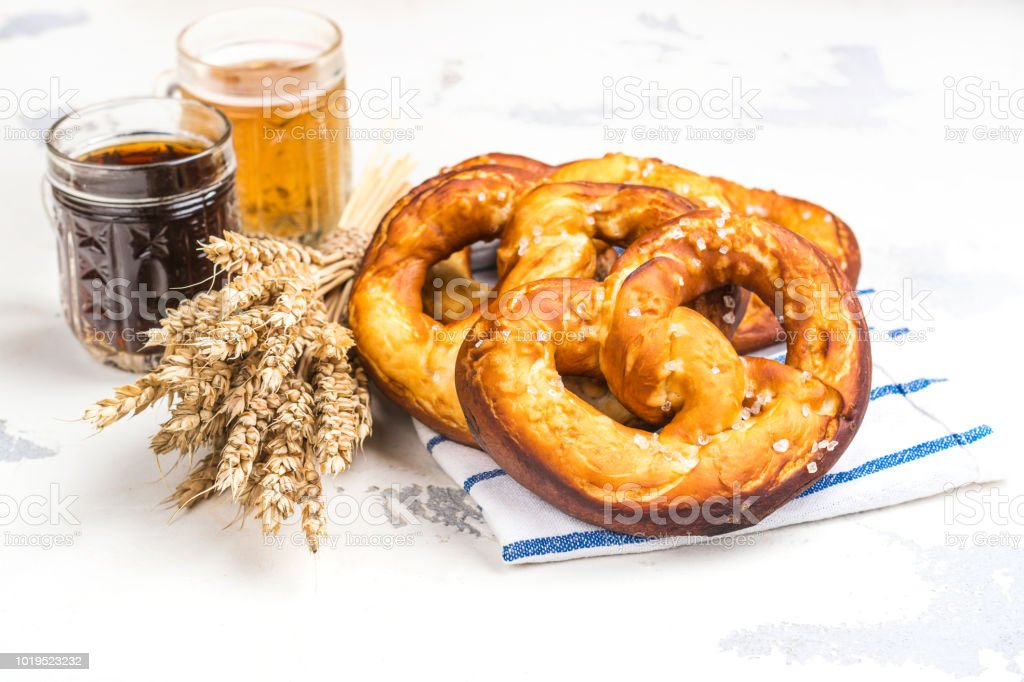 Beer and pretzels on white stock photo
