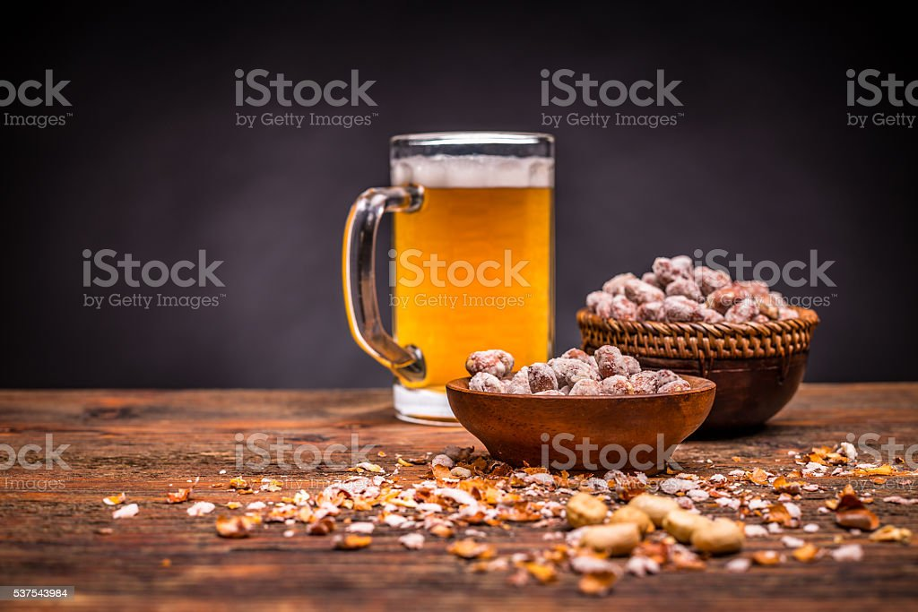 Beer and roasted peanuts stock photo
