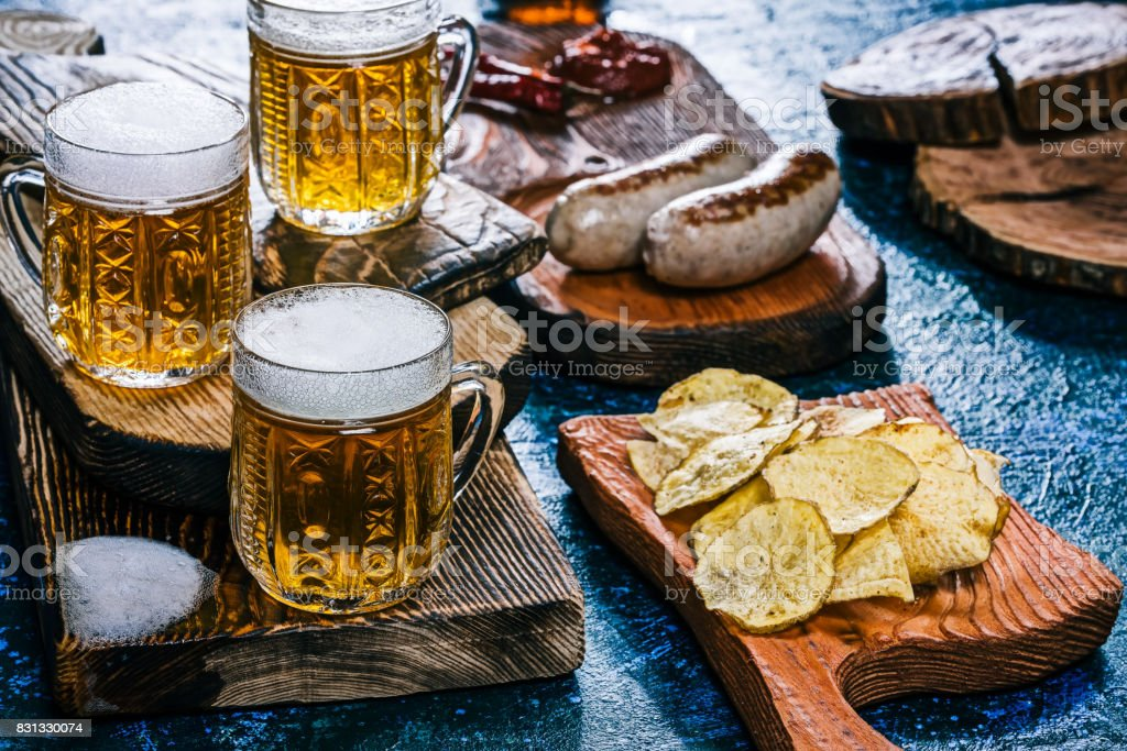 Beer and snack over spotty blue stock photo