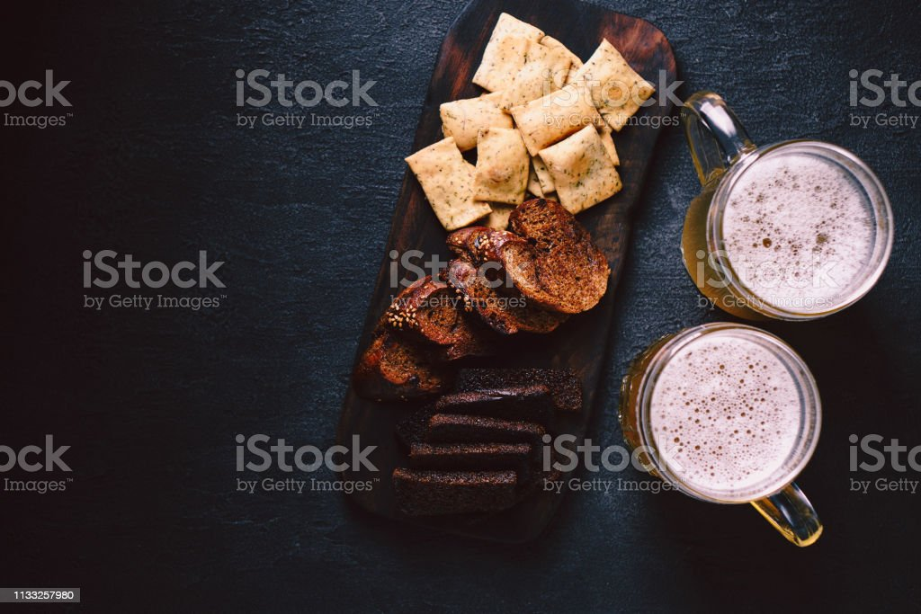 beer and snacks. bar table. restaurant, pub food stock photo