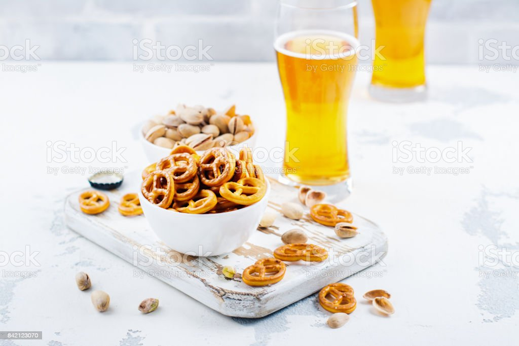Beer and snacks on white background stock photo