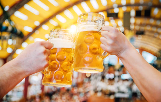 beer at oktoberfest in munich, germany - german culture stock pictures, royalty-free photos & images