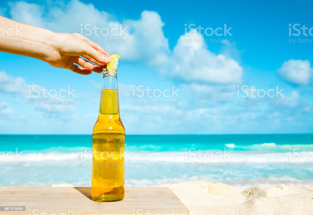 Beer at the beach stock photo