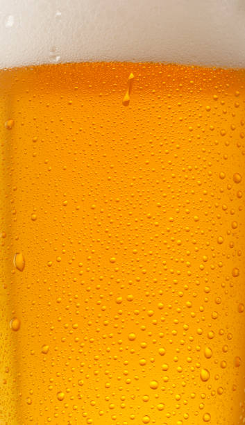 Beer Background. Ice Cold Beer Glass With Water Drops Condensation Vertical panoramic stock photo