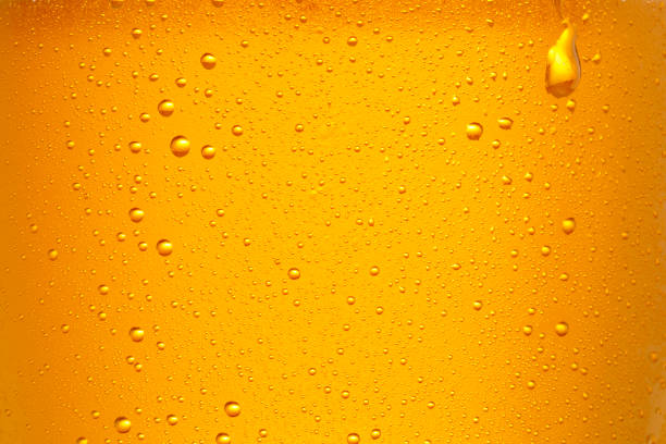 Beer Background. Ice Cold Beer Glass With Water Drops Condensation. Close up. stock photo