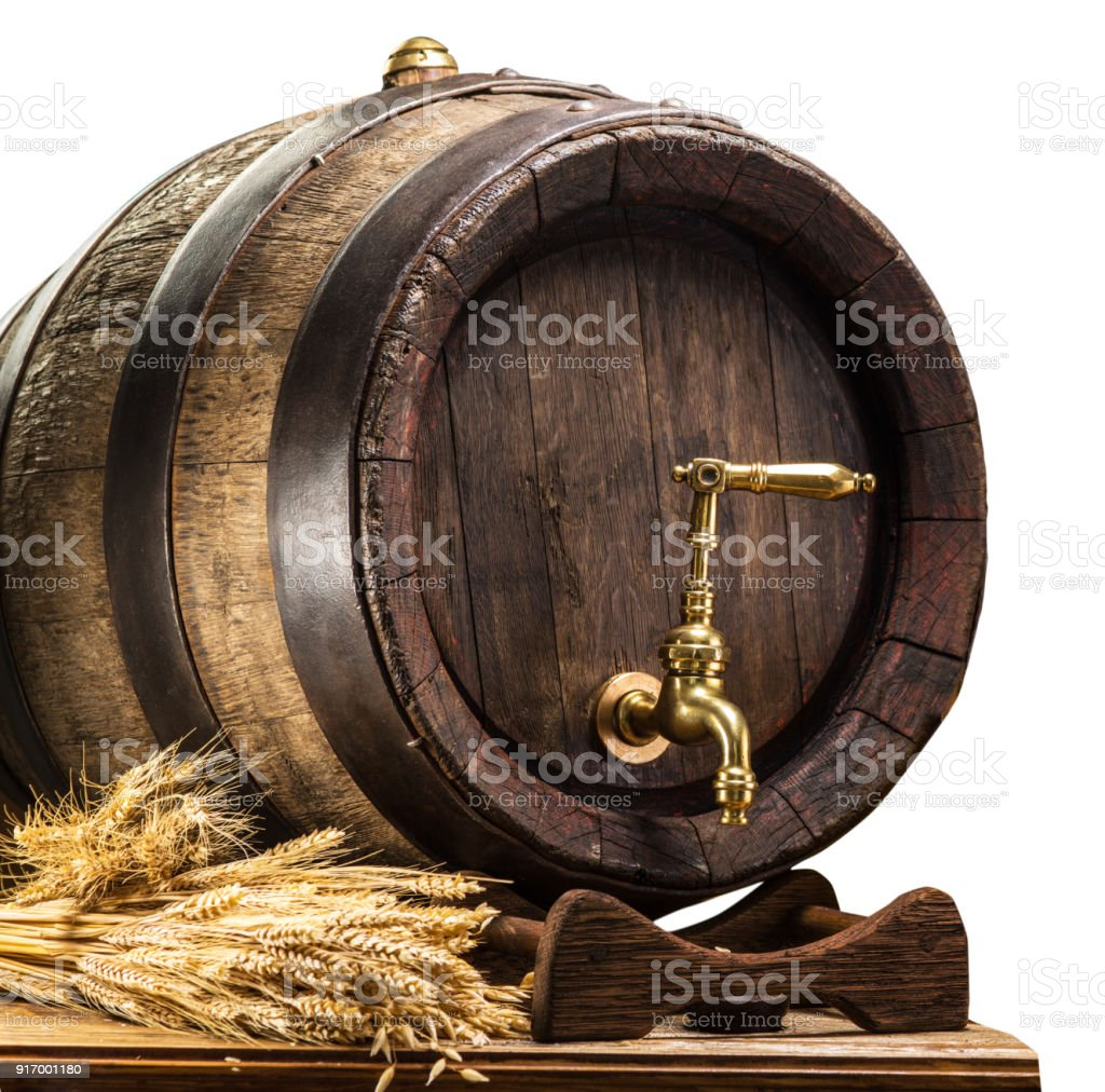 Beer barrel with bunch of wheat. stock photo