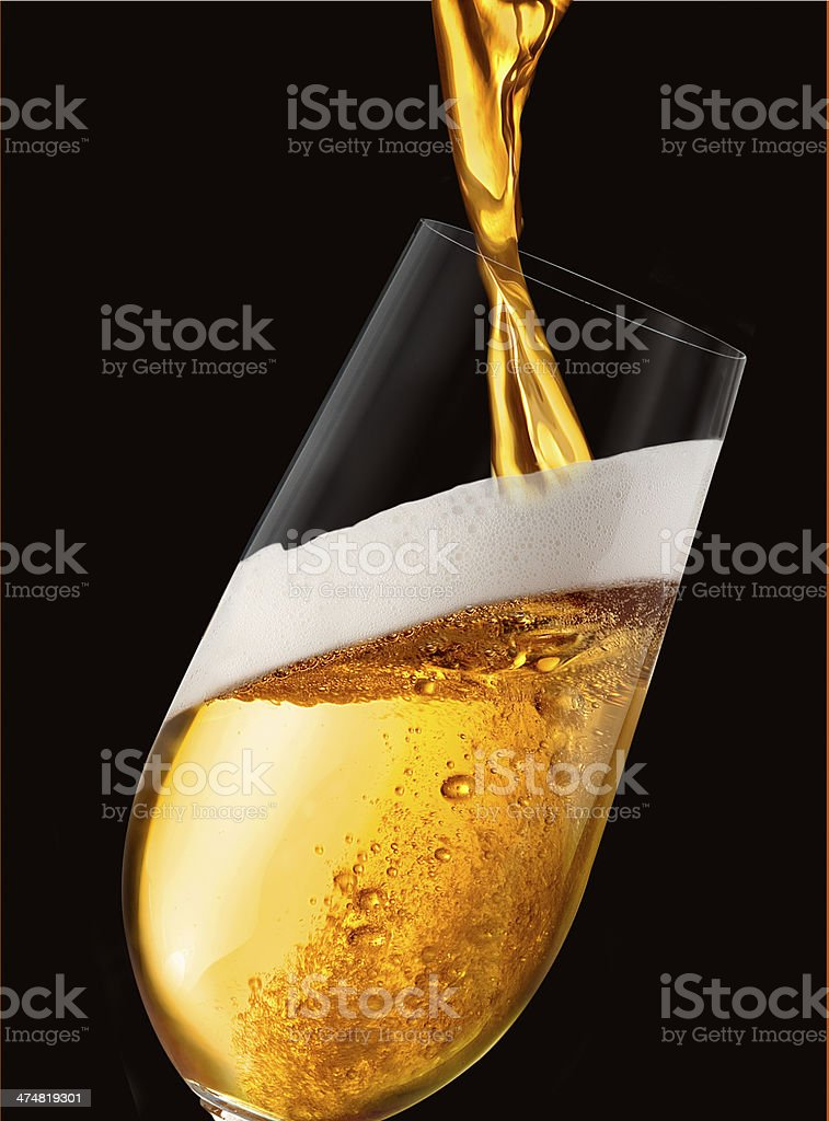 Beer being poured in Black Background stock photo