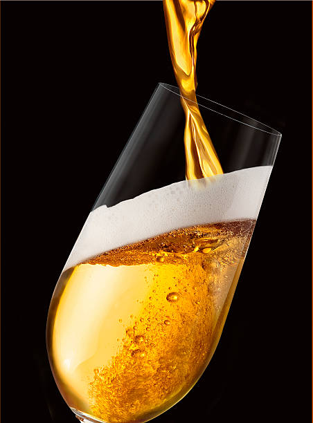 beer being poured in black background - beer pour stock photos and pictures