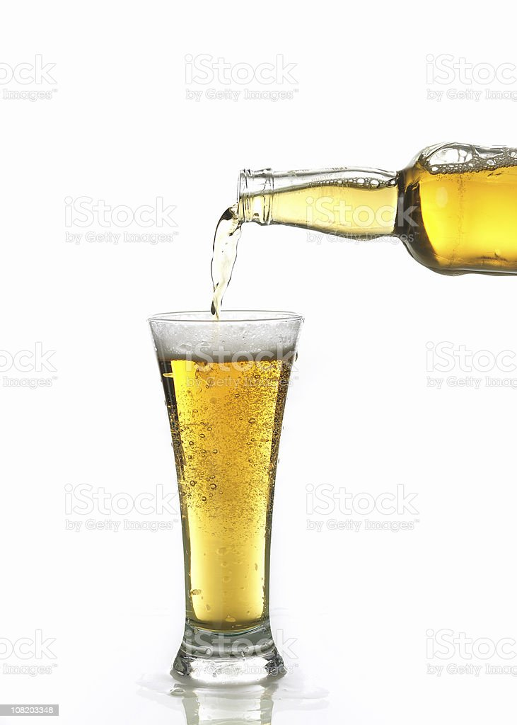 Beer Being Poured in Glass stock photo