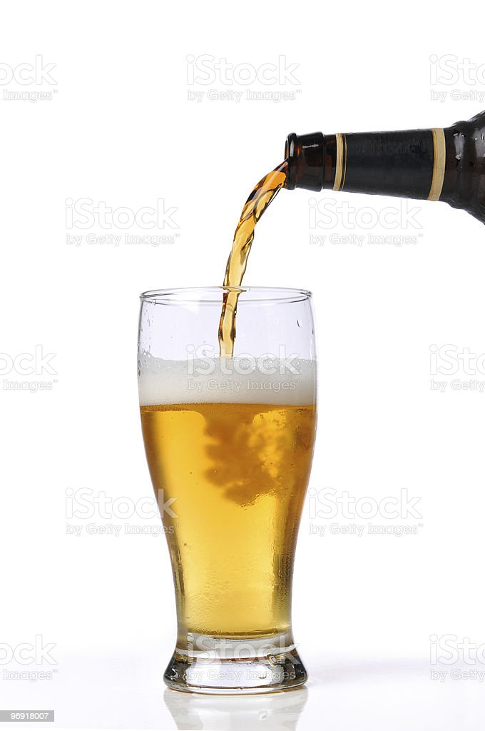 Beer being poured int0 a glass stock photo