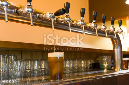 istock Beer being taken from the tap in brewpub 969592080