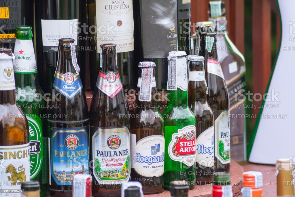 Beer beverage imported and local brand glass bottles at pub and restaurant in Thailand July 2012 stock photo