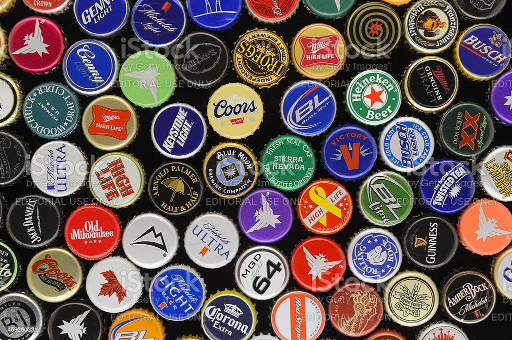 Beer Bottle Caps Variety Assortment, Black Background, Studio Shot stock photo