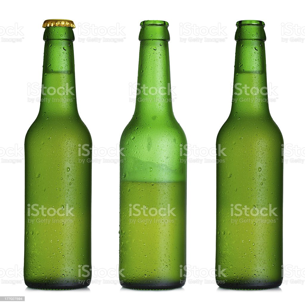 Beer bottle closed, half-full and opened stock photo