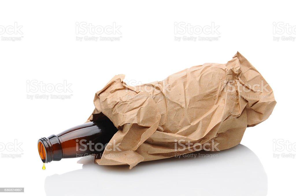 Beer Bottle in Brown Bag stok fotoğrafı