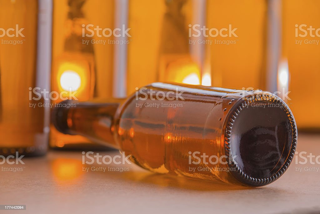 Beer bottle lying down royalty-free stock photo