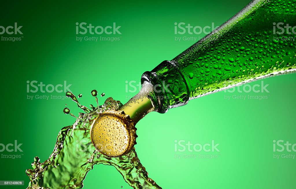 Beer bottle splashing stock photo