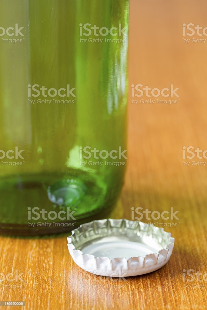 Beer bottle with a white ca royalty-free stock photo