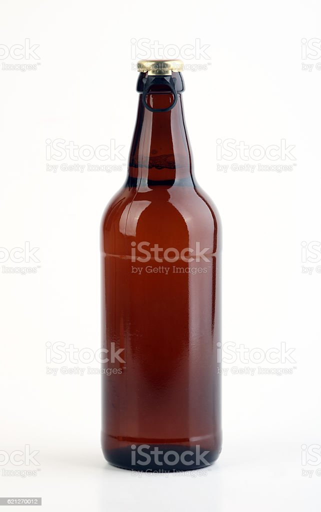 Beer bottle with cap stock photo