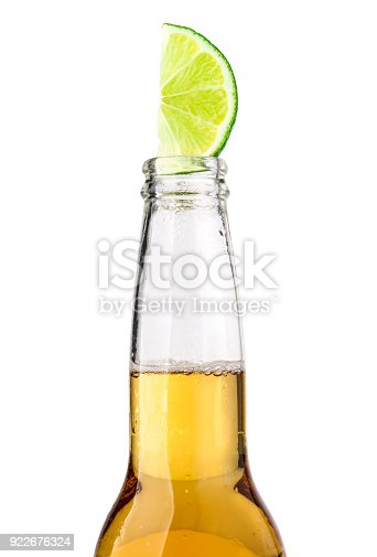 1073474208 istock photo beer bottle with lime slice 922676324