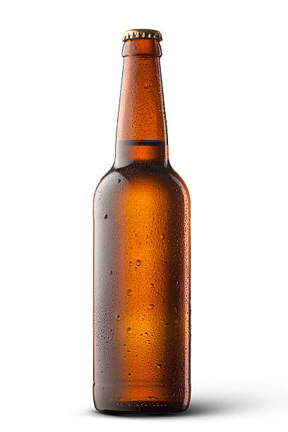 Beer bottle with water drops isolated on white stock photo
