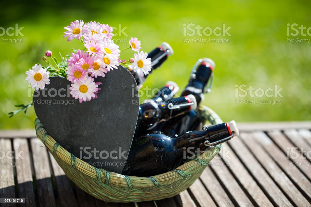 Beer bottles in basket, with heart for labeling, free text, Father's Day royalty-free stock photo