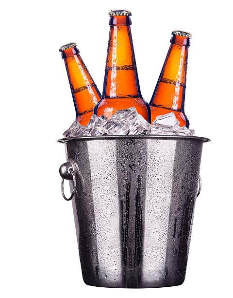 beer bottles in ice bucket isolated - emmer stockfoto's en -beelden