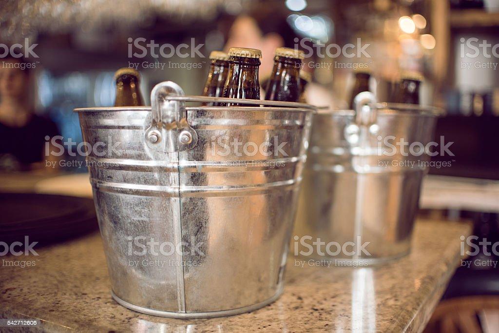 Beer bottles in ice bucket stock photo