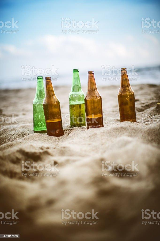 Beer bottles left on the beach stock photo