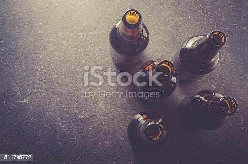 Beer bottles on dark table. Close up