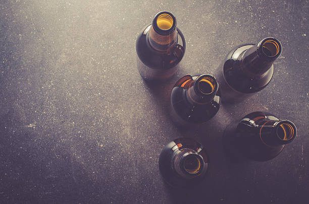 Beer bottles on dark table stock photo