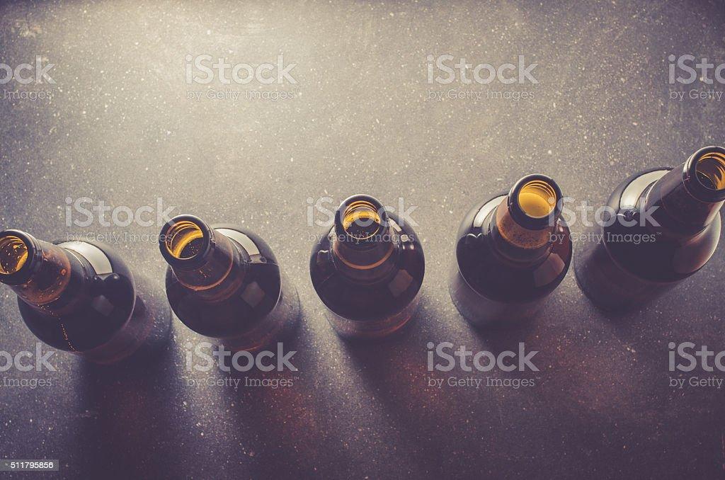 Beer bottles on dark table stock photo