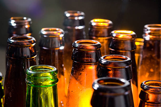 beer bottles - beer alcohol stock pictures, royalty-free photos & images