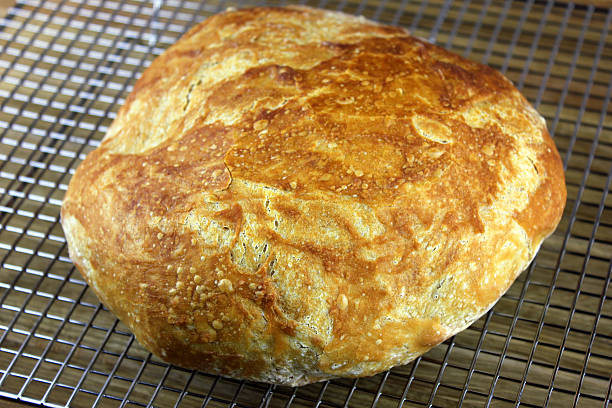 Beer Bread A fresh homemade beer bread cooling on a wire rack  round loaf stock pictures, royalty-free photos & images