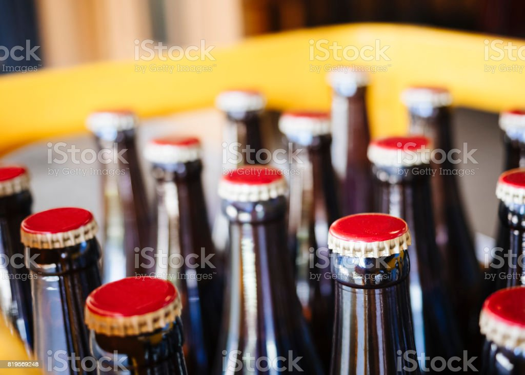 Beer Brewery packaging Bottles with cap close up stock photo