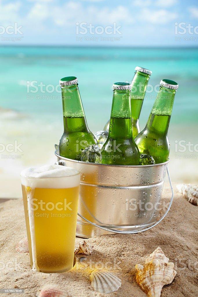 Beer bucket on the Beach stock photo
